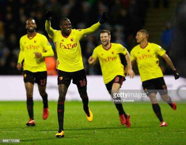 Abdoulaye Doucoure of Watford celebrates the own goal scored by Kasper Schmeichel of Leicester City with team mates during the Premier League match...