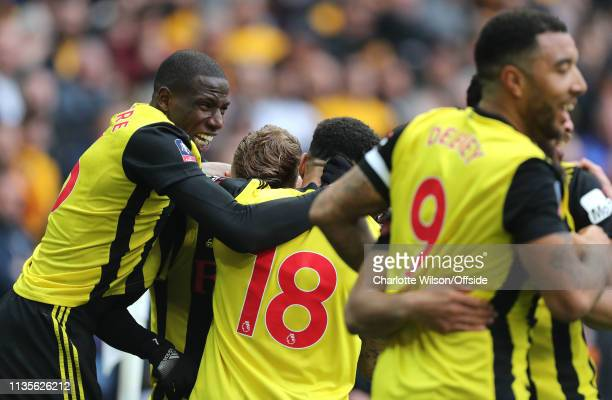 Abdoulaye Doucoure of Watford celebrates their third goal during the FA Cup Semi Final match between Watford and Wolverhampton Wanderers at Wembley...