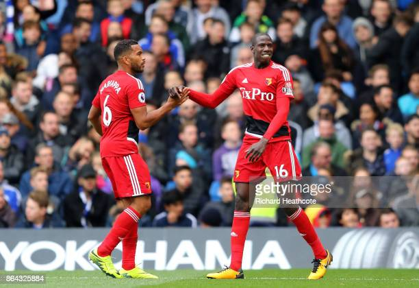 Abdoulaye Doucoure of Watford celebrates with Adrian Mariappa of Watford after scoring his sides first goal during the Premier League match between...