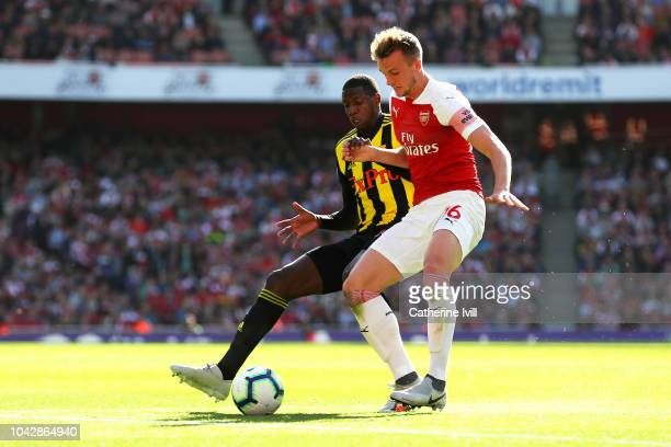 Abdoulaye Doucoure of Watford challenges for the ball with Rob Holding of Arsenal during the Premier League match between Arsenal FC and Watford FC...