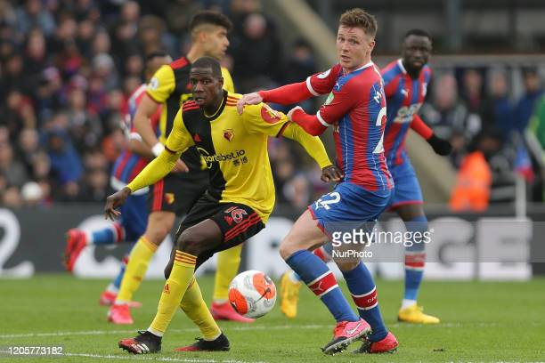 Abdoulaye Doucoure of Watford holding off James McCarthy of Crystal Palace during the Premier League match between Crystal Palace and Watford at...