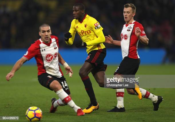 Abdoulaye Doucoure of Watford is challenged by Oriol Romeu of Southampton and James WardProwse of Southampton during the Premier League match between...