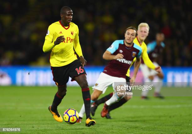 Abdoulaye Doucoure of Watford is chased by Mark Noble of West Ham United during the Premier League match between Watford and West Ham United at...