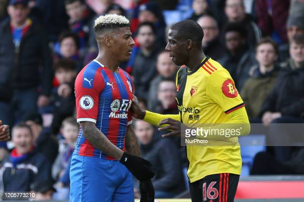 Abdoulaye Doucoure of Watford pushing Patrick Van Aanholt of Crystal Palace during the Premier League match between Crystal Palace and Watford at...