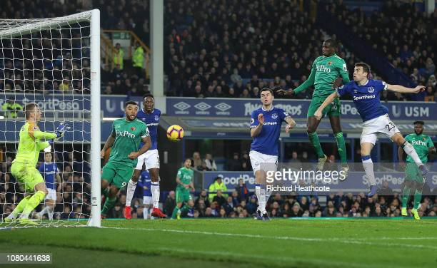 Abdoulaye Doucoure of Watford scores a header during the Premier League match between Everton FC and Watford FC at Goodison Park on December 10 2018...