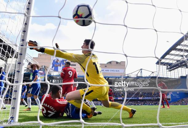 Abdoulaye Doucoure of Watford scores his sides first goal past Thibaut Courtois of Chelsea during the Premier League match between Chelsea and...