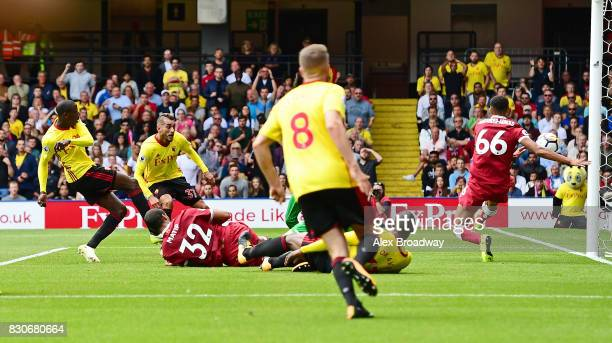 Abdoulaye Doucoure of Watford scores his sides second goal during the Premier League match between Watford and Liverpool at Vicarage Road on August...