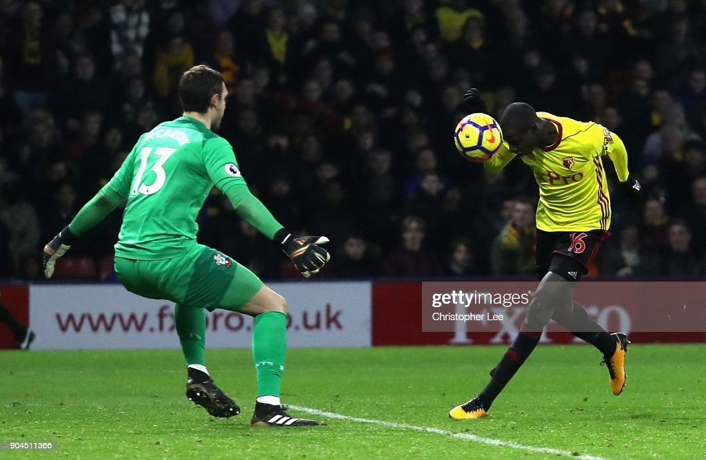 Abdoulaye Doucoure of Watford scores his sides second goal past Alex McCarthy of Southampton during the Premier League match between Watford and Southampton at Vicarage Road on January 13, 2018 in Watford, England.