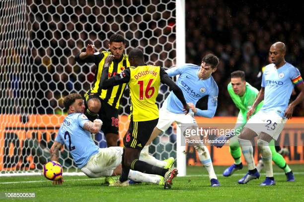 Abdoulaye Doucoure of Watford scores his team's first goal during the Premier League match between Watford FC and Manchester City at Vicarage Road on...
