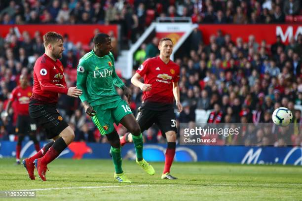 Abdoulaye Doucoure of Watford scores his team's first goal during the Premier League match between Manchester United and Watford FC at Old Trafford...