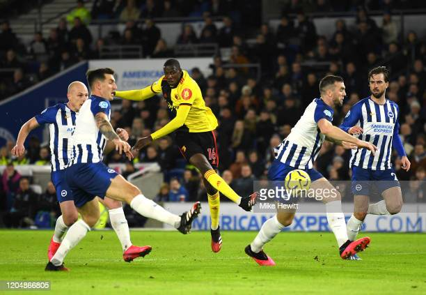 Abdoulaye Doucoure of Watford scores his team's first goal during the Premier League match between Brighton Hove Albion and Watford FC at American...