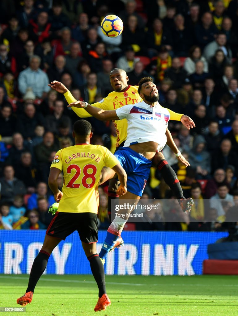 Abdoulaye Doucoure of Watford wins the ball in the air from Eric Maxim Choupo-Moting of Stoke City during the Premier League match between Watford and Stoke City at Vicarage Road on October 28, 2017 in Watford, England.
