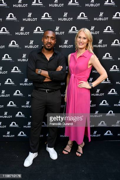 Abdoulaye Fadiga and Marlene Harnois attend the launch of Hublot x Champion Spirit on June 27 2019 in Paris France