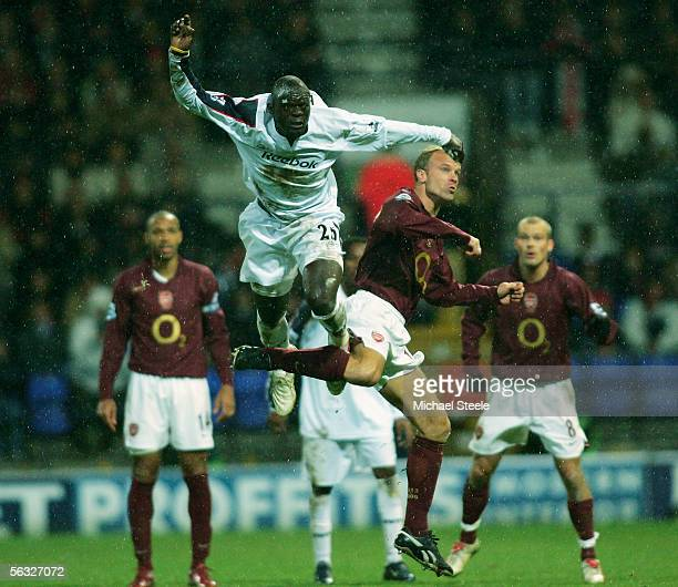 Abdoulaye Faye of Bolton clears from Dennis Bergkamp during the Barclays Premiership match between Bolton Wanderers and Arsenal at the Reebok Stadium...