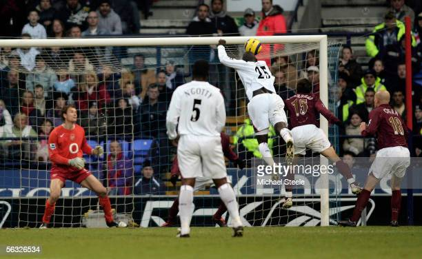 Abdoulaye Faye of Bolton scores the first goal during the Barclays Premiership match between Bolton Wanderers and Arsenal at the Reebok Stadium on...