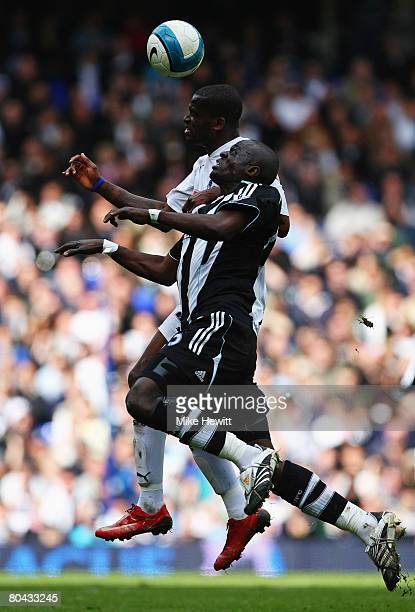 Abdoulaye Faye of Newcastle jumps for the ball with Darren Bent of Tottenham during the Barclays Premier League match between Tottenham Hotspur and...