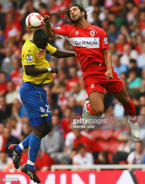 Abdoulaye Faye of Stoke and Mido of Middlesbrough challenge for the ball during the Barclays Premier League match between Middlesbrough and Stoke...