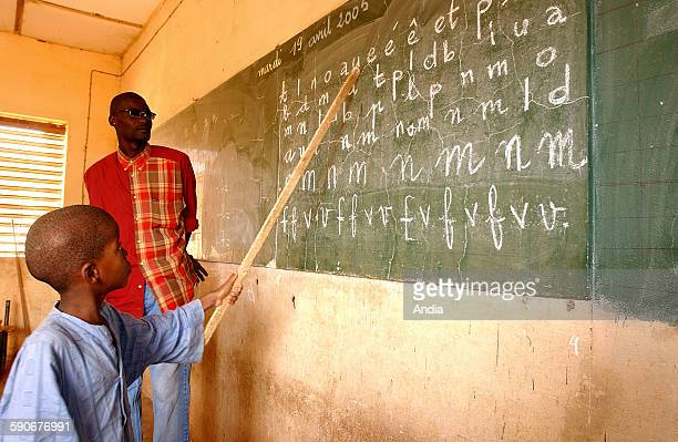 Abdoulaye Khady Diop public elementary school at Thies in Senegal Here a pupil reading the letters written on the board by his teacher