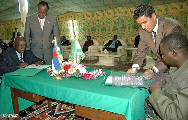 Abdoulaye Miskine rebel leader of the Union of Democratic Forces for the Rally and Paul Otto Central African Republic Justice Minister sign a peace...