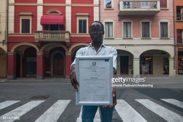 Abdoulaye proudly shows his diploma obtained in Italy after his arrival This diploma is his admission and registration with the Italian authorities...