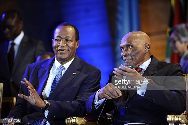 Abdoulaye Wade President of Senegal and Blaise Compaoré President of Burkina Faso take part in a ceremony to honor the Argentina's nongovernmental...