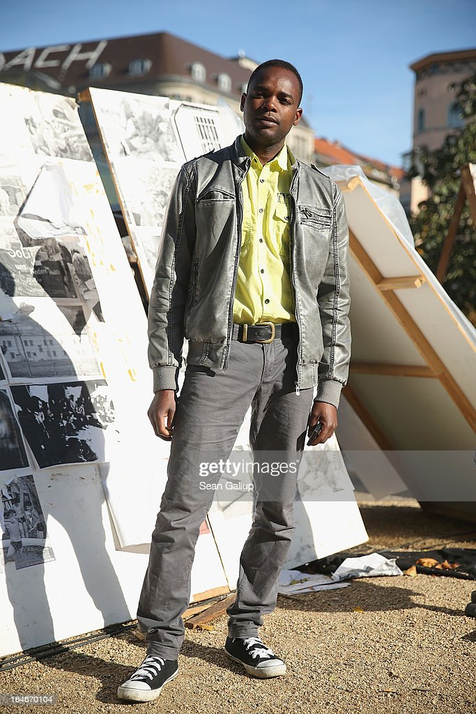Abdousalam, 30, who is a refugee from Niger, poses for a photograph at the makeshift camp where he and approximately 100 other refugees are living at Oranienplatz in Kreuzberg district on October 14, 2013 in Berlin, Germany. Berlin authorities have tolerated the camp at Oranienplatz and have promised to move the refugees to proper housing ahead of the coming winter.