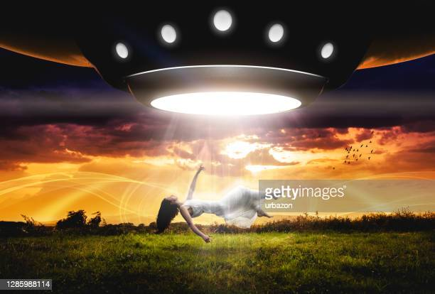 ufo abducts woman - military invasion stock pictures, royalty-free photos & images