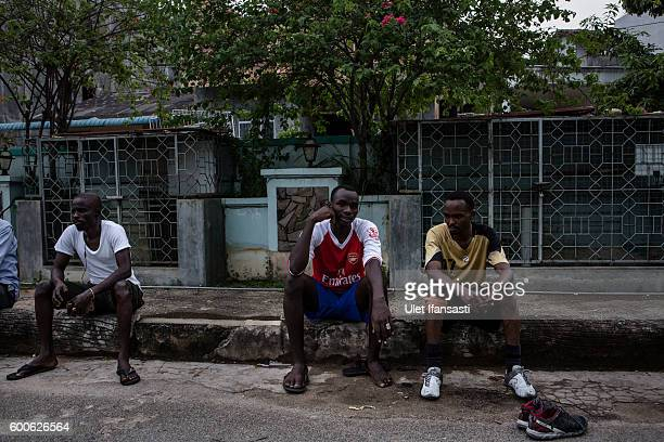 Abdul a Sudanese asylum seeker sits and takes a rest after playing football in front of the Kolekta hotel where hundreds of refugees and asylum...