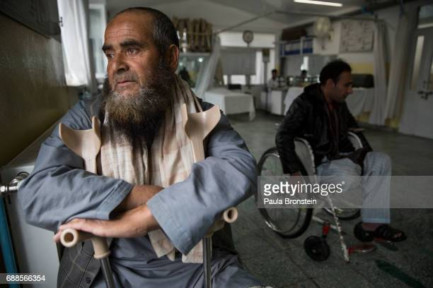 Abdul Ahad a double amputee from a mine explosion in Ghazni rests after a day of walking on his new prosthetics 'nAt the ICRC Orthopedic center...