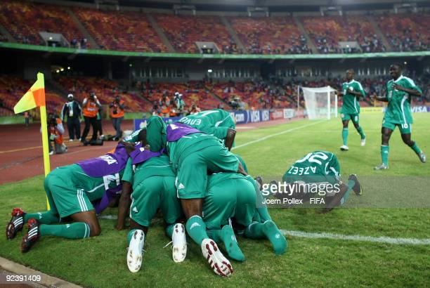 Abdul Ajagun of Nigeria celebrates with his team mates after scoring his team's first goal during the FIFA U17 World Cup Group A match between...