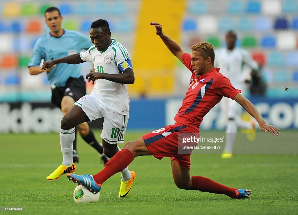 Abdul Ajagun of Nigeria is tackled by Abel Martinez (R) of Cuba during the FIFA U-20 World Cup Group B match between Cuba and Nigeria at Kadir Has Stadium on June 24, 2013 in Kayseri, Turkey.
