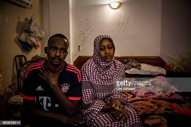 Abdul and his wife Fauziah asylum seekers from Sudan sit inside their room in Kolekta hotel where hundreds of refugees and asylum seekers stay for...