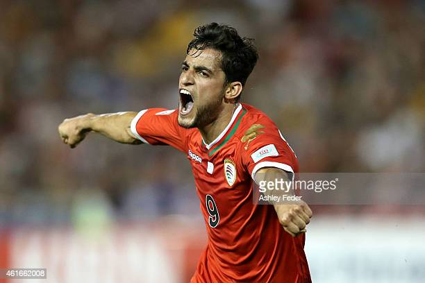 Abdul Aziz Al-Maqbali of Oman celebrates a goal during the 2015 Asian Cup match between Oman and Kuwait at Hunter Stadium on January 17, 2015 in...