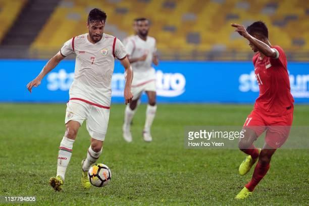 Abdul Aziz Humaid Mubarak of Oman and Muhammad Safuwan of Singapore in action during the Airmarine Cup final between Singapore and Oman at Bukit...