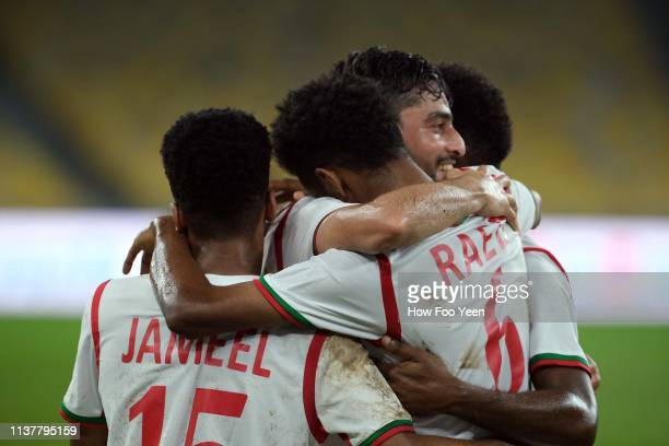 Abdul Aziz Humaid of Oman celebrates after scoring the opening goal during the Airmarine Cup final between Singapore and Oman at Bukit Jalil National...