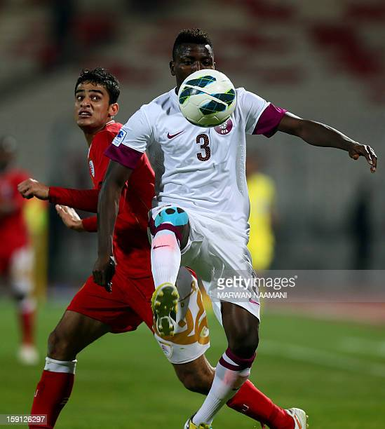 Abdul Aziz Mubarak of Oman vies for the ball against Kasola Mohammed of Qatar during their 21st Gulf Cup football match in Manama on January 8 2013...