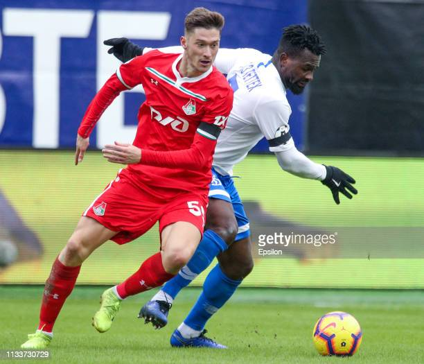Abdul Aziz Tetteh of FC Dinamo Moscow is challenged by Aleksei Miranchuk of FC Lokomotiv Moscow during the Russian Premier League match between FC...