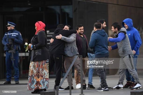 Abdul Aziz, who saved lives by running at the gunman at the Linwood Islamic Centre , greets other victims and their support people as they arrive for...