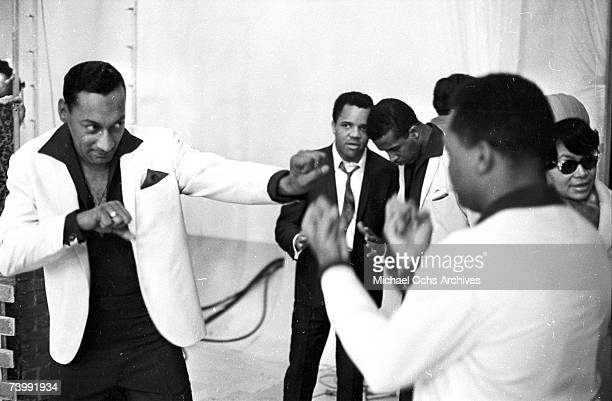 Abdul Duke Fakir and Ronaldo Obie Benson of the RB vocal group The Four Tops pretend to box as the head of Motown Berry Gordy chats with lead singer...