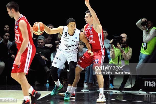 Abdul Gaddy of Obiettivo Lavoro competes with Andrea Cinciarini of EA7 during the LegaBasket match between Virtus Obiettivo Lavoro and EA7 Emporio...