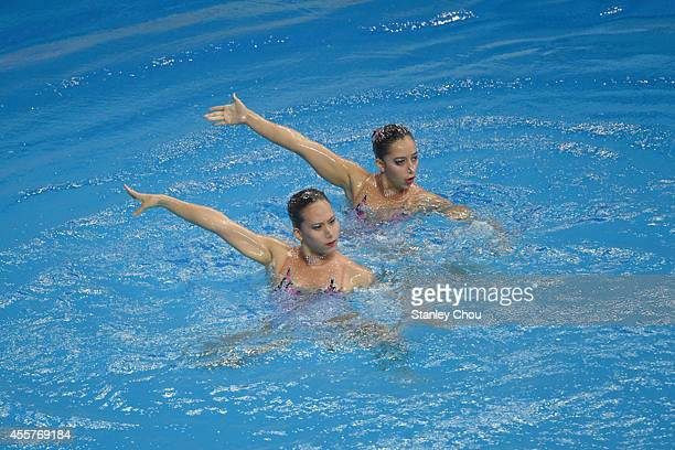 Abdul Hadi Ka and Lee Yhing Huey of Malaysia performs during the Synchronised Swimming Duet Free Routine Final during day one of the 2014 Asian Games...