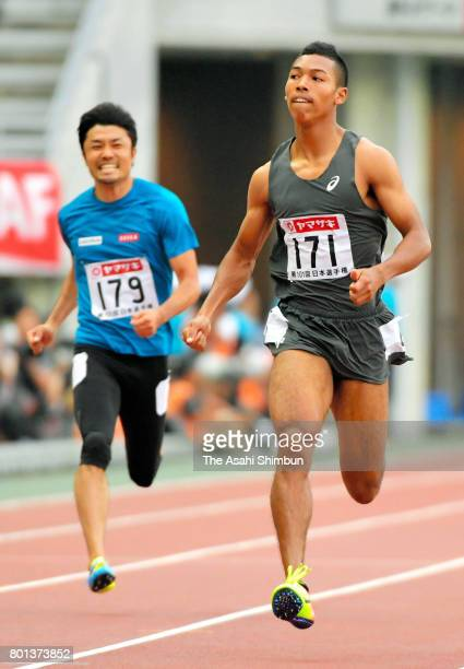 Abdul Hakim Sani Brown and Shingo Suetsugu compete in the Men's 200m heat during day two of the 101st JAAF Athletics Championships at Yanmar Stadium...