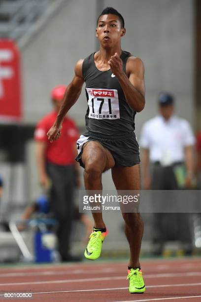 Abdul Hakim Sani Brown of Japan competes in the Men 100m semi final during the 101st Japan National Championships at Yanmar Stadium Nagai on June 23...