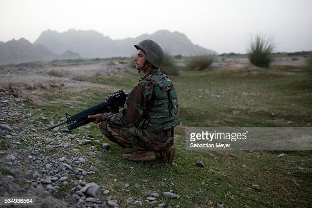 Abdul Karim a soldier with the Afghan National Army patrols with Bravo Troop in southern Pashmul Bravo Bonecrusher Troop of the 175 Cavalry 101st...