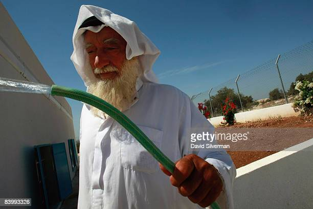 Abdul Latif Salman Hamad the caretaker of a renovated well keeps the pumphouse clean as it distributes water to Palestinian farmers and homes in the...