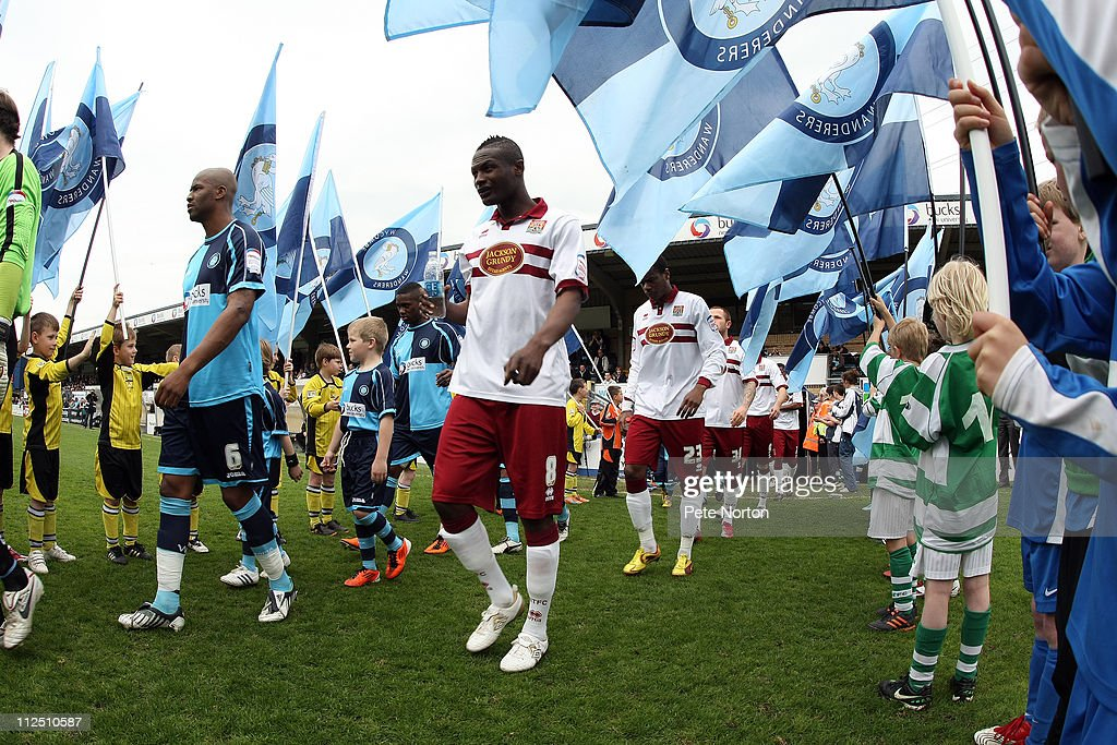 Abdul Osman of Northampton Town (R) and Leon Johnson of Wycombe Wanderers enter the pitch prior to the start of the the npower League Two League match between Wycombe Wanderers and Northampton Town at Adams Parks on April 16, 2011 in Wycombe, England.