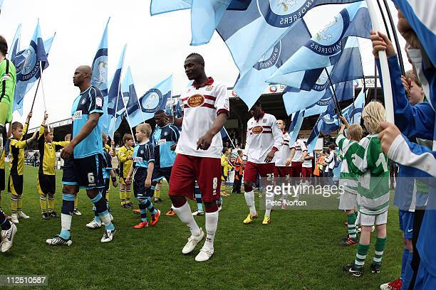 Abdul Osman of Northampton Town and Leon Johnson of Wycombe Wanderers enter the pitch prior to the start of the the npower League Two League match...