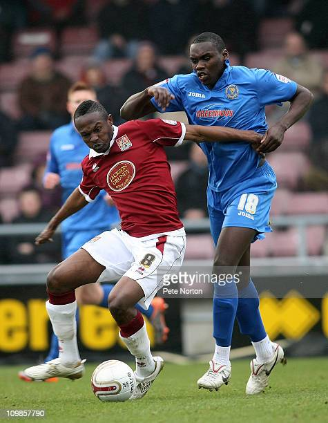 Abdul Osman of Northampton Town attempts to control the ball under pressure from Jermaine Grandison of Shrewsbury Town during the npower League Two...