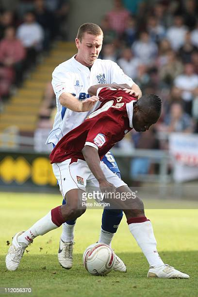Abdul Osman of Northampton Town attempts to control the ball under pressure from Peter Sweeney of Bury during the npower League Two League match...