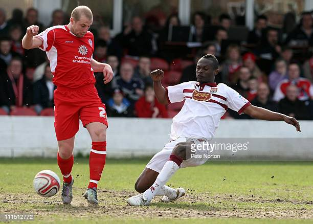 Abdul Osman of Northampton Town challenges for the ball with Ian Craney of Accrington Stanley during the npower League Two League match between...